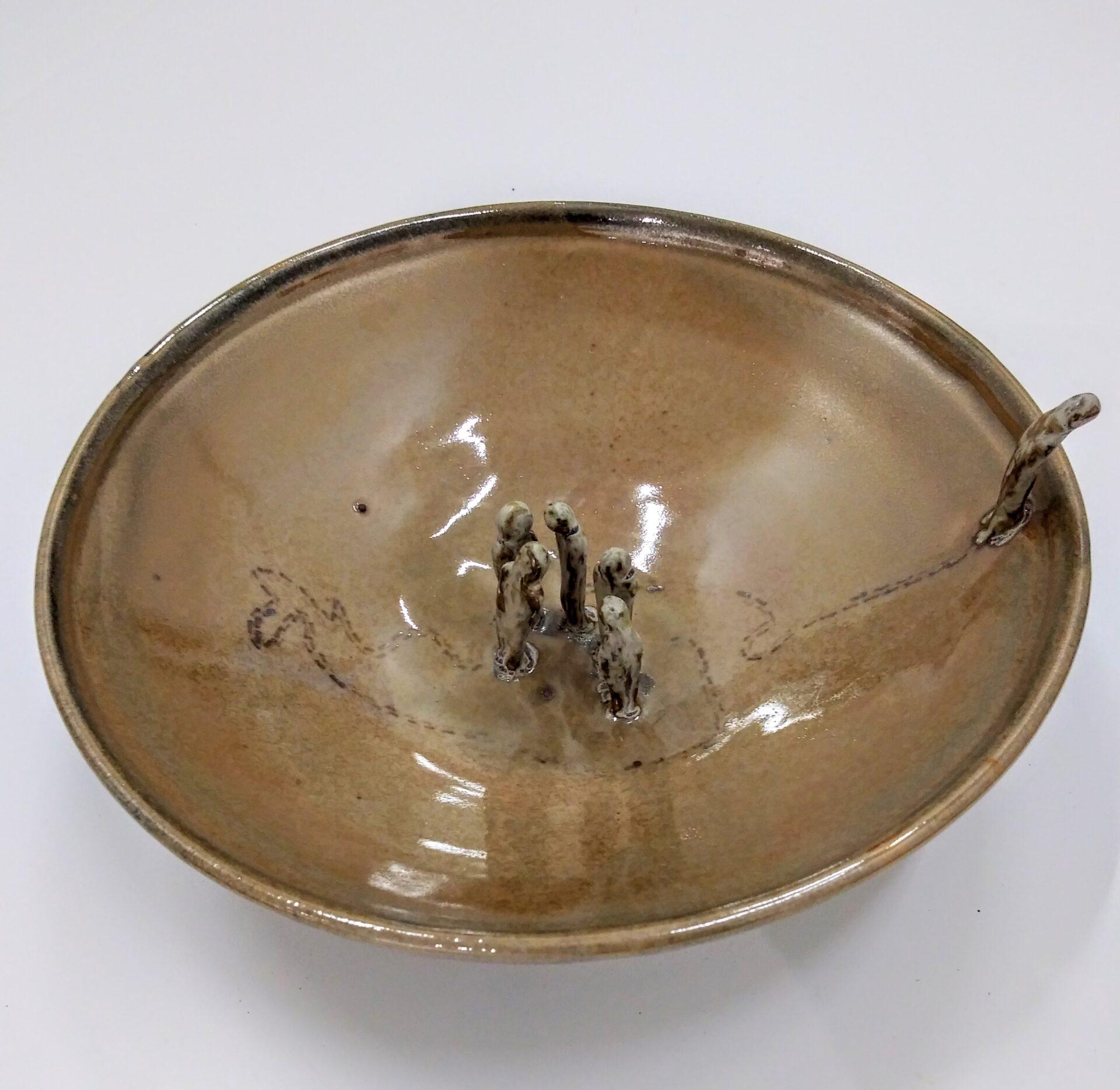 Ceramic art sculpture of a copper colored bowl